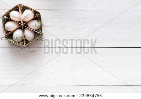 Thin Wood Box With Six Eggs On White Wooden Background, Copy Space. Top View On Kitchen Table With N