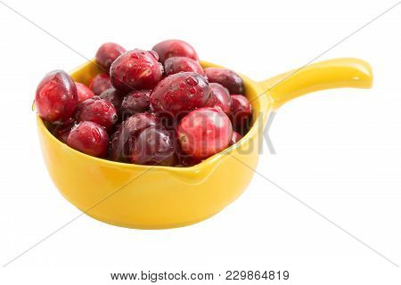 Isolated Cranberries In A Ceramic Yellow Bowl