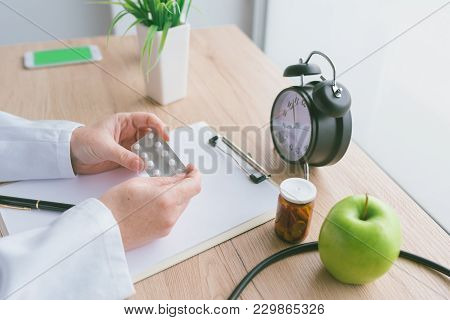 Female Doctor Holding Unlabeled Generic Tablets And Medication, Generic Drugs Concept, Prescription