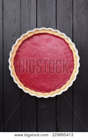 Nordic Dessert. Tasty Homemade Red Lingonberry Cowberry Pie On Black Wooden Background Copyspace Ove