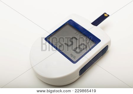 Small Portable Digital Blood Glucose Meter For Use By A Diabetic To Self Monitor And Medicate The Di