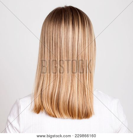 Female Blonde hair, rear view, isolated on white background