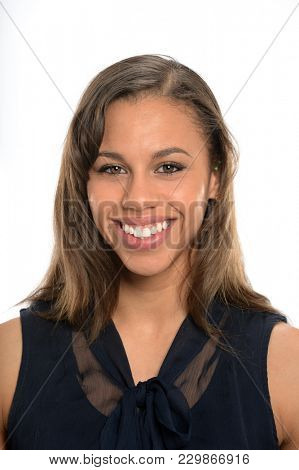 Portrait of young African American businesswoman smiling isolated over white background