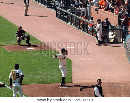 Giants Matt Cain Steps Forward To Throw Pitch To Catcher Buster Posey During Bullpen Warm-up Session