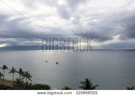 High Angle View Vast Seascape With Palm Trees And Beach In Foreground And Island In Background