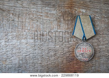 The Old Soviet Medal For Bravery Of The Second World War With A Red Carnation, Victory Day May 9 Pos