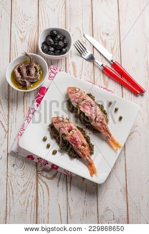 red mullet with sauteed endive capers and black olives
