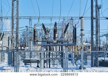 High-voltage Circuit Breakers At Electrical Substations Connected With Electric Wires. Insulators On
