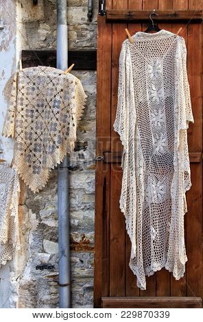 Hand Made Laces And Needlework Hang On Shop Wall, Village Pano Lefkara, Cyprus.