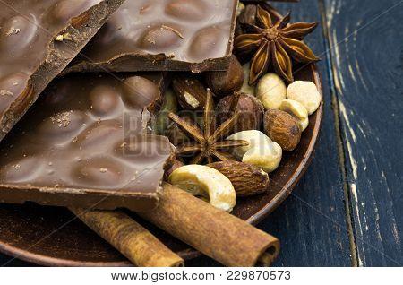 Background Of Chocolate. Chocolate With Hazelnut. Low Key