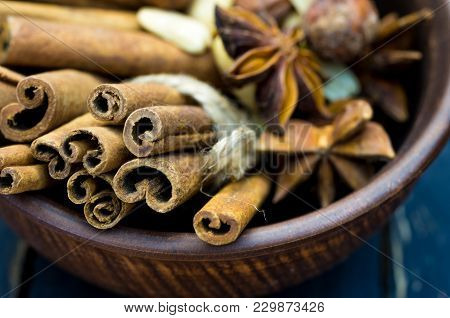 The Photo Of The Seasonings Is Close. Photo Of Cinnamon Stick Is Close-up. Cinnamon, Nuts, Seeds And