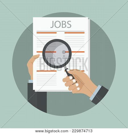 Search The Job On Newspaper Concept. Newspaper On Job Vacancy Page With Hand Holding Magnifying Glas