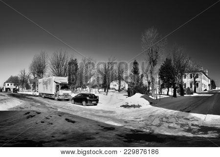 Hora Svateho Sebestiana, Czech Republic - February 25, 2018: Cars On Snowy Square In Winter Ore Moun