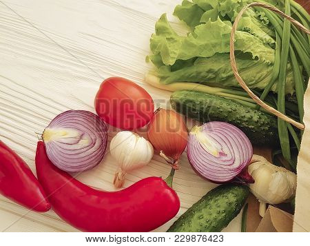 Organic Vegetables On A White Wooden Paper Bag