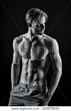 Bodybuilder With Sexy Torso, Six Pack, Ab, Biceps, Triceps, Muscles. Man Athlete Show Muscular Torso