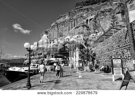 Santorini, Greece - July 15, 2017: Bay With Tourist People In Summer Near Mountain With Building