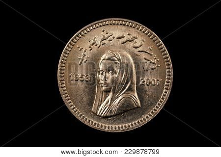 A Super Macro Image Of A 10 Pakistani Rupee Coin Isolated On A Black Background
