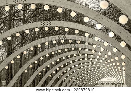 Semicircular Wooden Slab Of A Overlapping Bridge In The Form Of An Arch With The Illumination Of Lig
