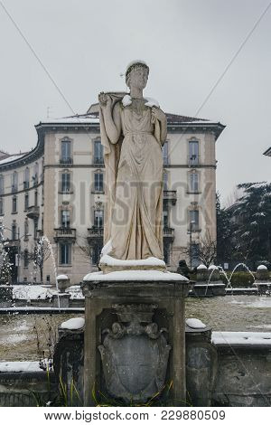 Milan, Lombardy, Italy, Statue And Fountain In Giulio Cesare Square, Near The New Citylife Area