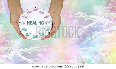 The Time For Healing Is Now - Female Hands Holding A Clock With No Hands That Has Now In Place Of Th