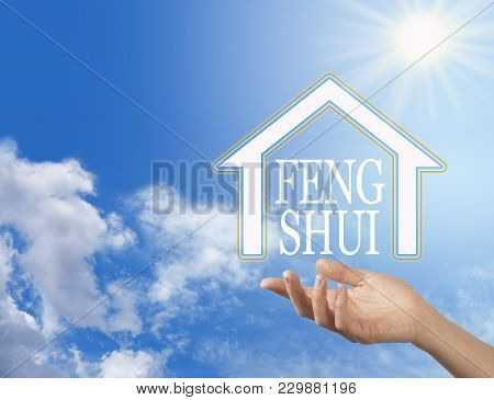 Let The Enlightened Wisdom Of Feng Shui Into Your Home - Female Hand With A House Shape Containing T