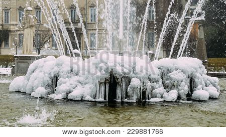 Milan, Lombardy, Italy, Statues And Fountain In Giulio Cesare Square, Near The New Citylife Area