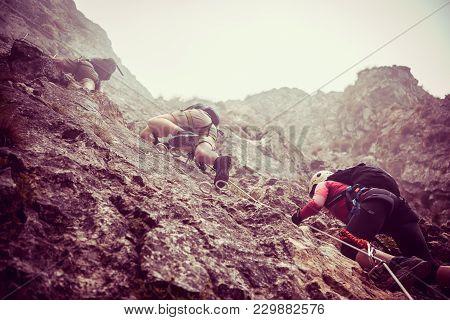 Young Friends On Via Ferrata, Tourists On Ferrata, Via Ferrata In Mountains, Group On Ferrata In Mou