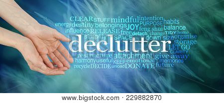 Angelic Feather Declutter Word Cloud - Female Cupped Hands Offering The Word Declutter Surrounded By