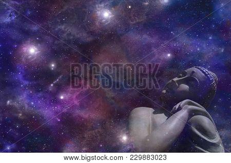Cosmic Buddha Basking In Star Light - Buddha Gazing Up At The Heavens Against A Dark Blue Starry Nig