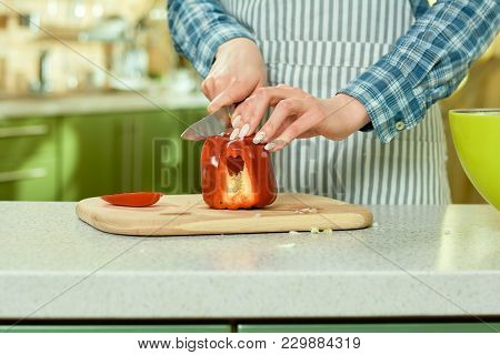 Female Hands Cutting Paprika. Bell Pepper On Cooking Board.