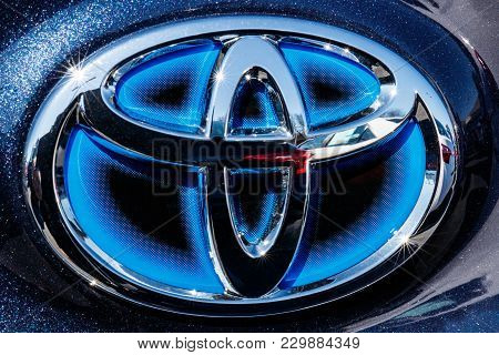 Indianapolis - Circa March 2018: Toyota Blue Hybrid Vehicle Logo And Badge. Toyota Is A High Quality