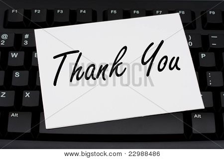 Computer keyboard with a thank you card Thank you for your business poster