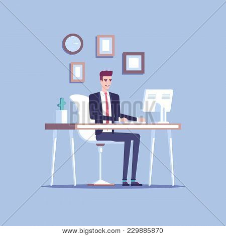 Smiling Young Businessman Or Male Clerk Sitting At The Office Desk And Working At The Computer And L