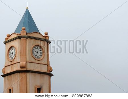 A Clock Tower Providing A Visual Time Of Day To The Bystanders Below.