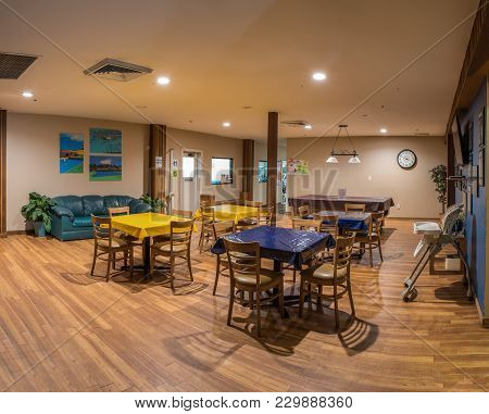 Tables And Chairs Available For Breakfast, Lunch, Or Dinner At Pierpont Racquet Club Restaurant In V