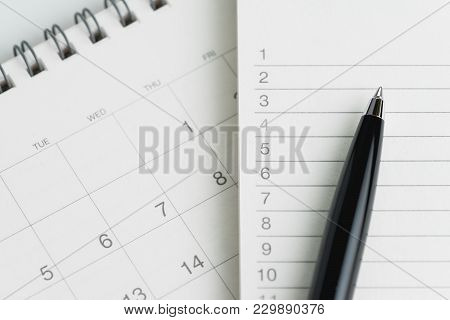 Writing To Do List Or Work Target Plan Concept, Black Pen On Notepad With List Of Numbers On Clean D