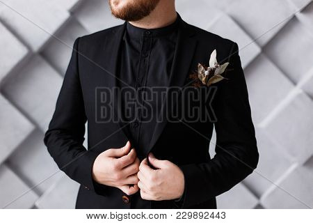 Close Up Half Face Portrait Of Bearded Boss In Black Suit And Shirt Standing Over Grey Geometric Bac