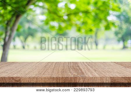 Empty Wood Table Over Blur Green Park Nature Background, Tabletop, Shelf, Counter For Product Displa