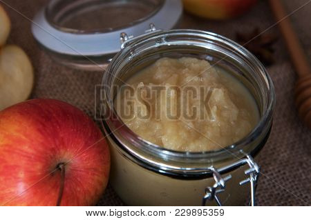 Fresh Homemade Applesauce With Apples On A Wooden Table