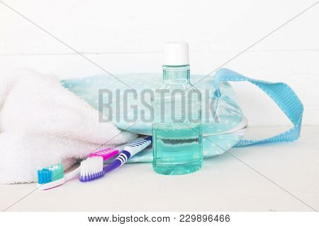 Mouthwash With Toothbrush In Little Bag For Healthy Care Oral Cavity On Background White