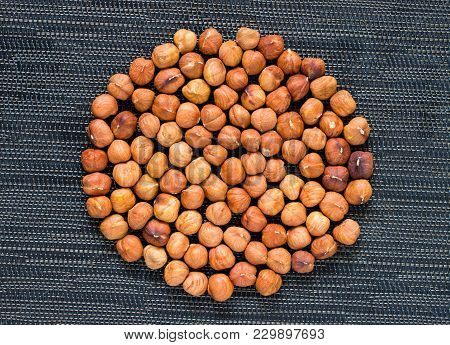 Hazelnut Heap On Dark Background. Ripe Hazel Nut For Food. Organic Food Rustic Banner Template. Tast