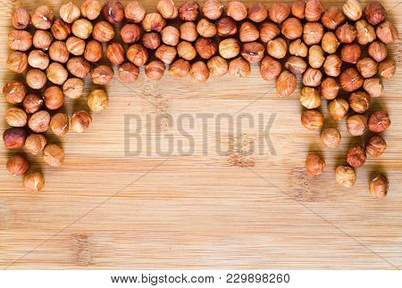 Hazelnut Frame On Wooden Background. Ripe Hazel Nut For Food. Organic Food Rustic Banner Template Wi