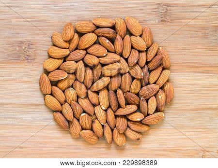 Almond Heap On Wooden Background. Ripe Almond Nut For Food. Organic Food Rustic Banner Template. Tas