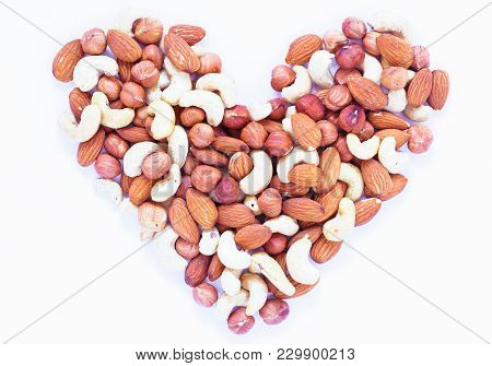 Nut Heart On White Background. Almond, Cashew, Hazelnut Nuts. Organic Food Rustic Banner Template. T