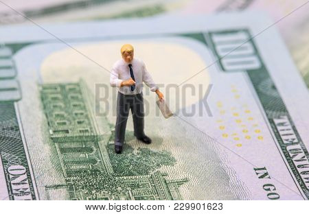 Businessman Presents Financial Result. Businessman Figurine On Dollar Banknote. Modern Economics And
