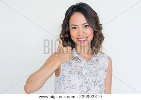 Happy Asian Woman Showing Thumb Up. Young Lady Expressing Positive Feelings Or Showing Support To So