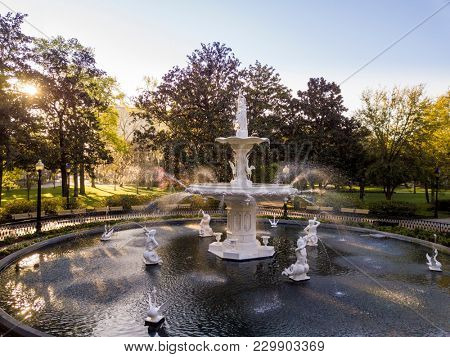 SAVANNAH, GEORGIA-MARCH 5, 2018: View of the historic fountain in Forsyth Park in Savannah, Georgia. The fountain was installed in 1858.