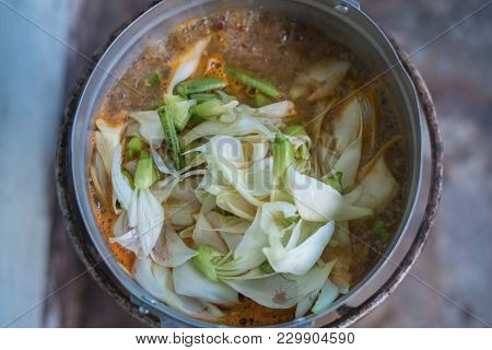 Hot And Sour Katuri Flower Soup In The Pot On Picnic Gas Stove