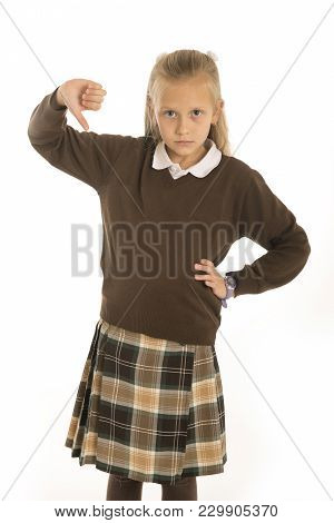 7 Or 8 Years Old Sad And Frustrated  Schoolgirl Female Child In Uniform Suffering Bullying Or Dislik