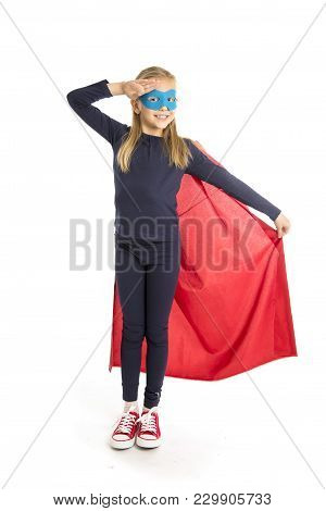 7 Or 8 Years Old Young Female Schoolgirl Child In Super Hero Costume Performing Happy And Excited Is